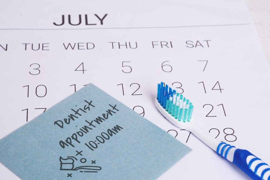 """Calendar with a note that says """"dentist appointment"""""""